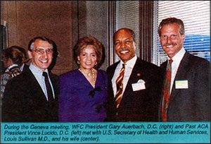 WFC President Gary Auerbach DC, Past ACA President Vince Lucido DC, and US Secretary of Health and Human Services Louis Sullivan MD, and his wife. - Copyright – Stock Photo / Register Mark