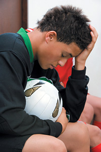athlete with headache - Copyright – Stock Photo / Register Mark