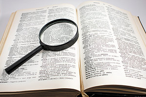 book and magnifying glass - Copyright – Stock Photo / Register Mark