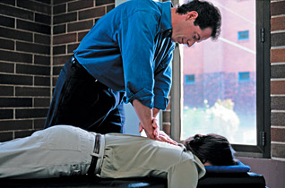 chiropractor adjustment - Copyright – Stock Photo / Register Mark