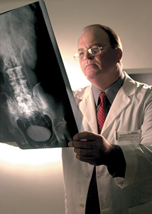 doctor viewing xray - Copyright – Stock Photo / Register Mark