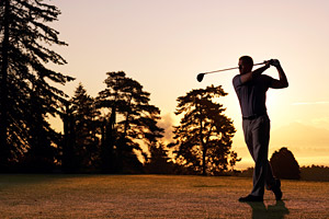 Man golfing - Copyright – Stock Photo / Register Mark