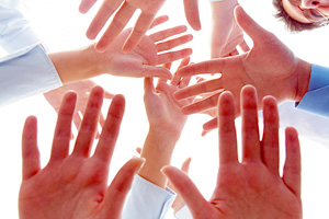 gathering hands - Copyright – Stock Photo / Register Mark