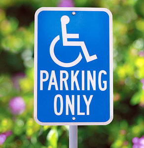 handicap parking sign - Copyright – Stock Photo / Register Mark
