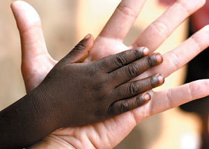 Helping Hands in Haiti - Copyright – Stock Photo / Register Mark