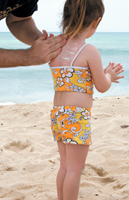 kid with sunscreen - Copyright – Stock Photo / Register Mark