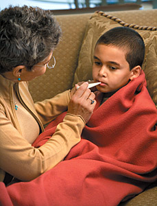 kid with fever - Copyright – Stock Photo / Register Mark