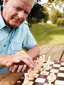 man playing chess - Copyright – Stock Photo / Register Mark