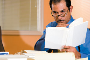 man reading book - Copyright – Stock Photo / Register Mark