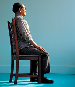 man sitting with good posture - Copyright – Stock Photo / Register Mark