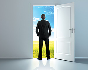 man standing in door - Copyright – Stock Photo / Register Mark