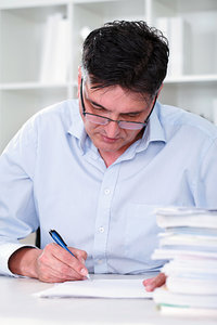 man writing note - Copyright – Stock Photo / Register Mark
