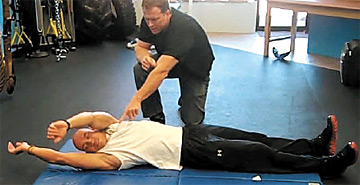 Supine to prone upper-extremity roll