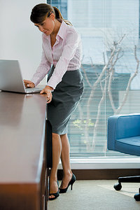 standing at desk - Copyright – Stock Photo / Register Mark