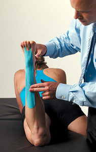 doctor taping patient
