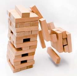 toppling jenga - Copyright – Stock Photo / Register Mark