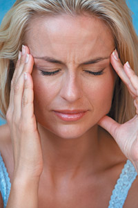 woman with headache - Copyright – Stock Photo / Register Mark
